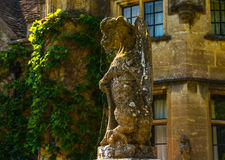 Old sculpture on the pedestal, beautifully preserved old artisti Stock Photos