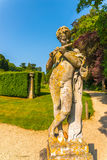 Old sculpture on the pedestal, beautifully preserved old artisti Royalty Free Stock Image