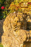 Old sculpture on the pedestal, beautifully preserved old artisti Royalty Free Stock Photos