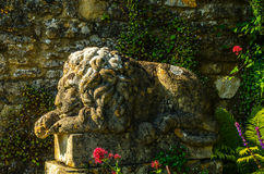 Old sculpture on the pedestal, beautifully preserved old artisti Stock Photo