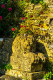 Old sculpture on the pedestal, beautifully preserved old artisti Royalty Free Stock Images
