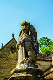 Old sculpture on the pedestal, beautifully preserved old artisti Royalty Free Stock Photography