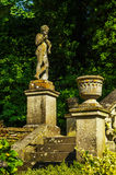 Old sculpture on the pedestal, beautifully preserved old artisti Stock Image