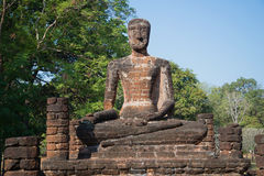 Old sculpture of a seated Buddha at the ruins of the Buddhist temple. Kamphaeng Phet, Thailand Royalty Free Stock Images