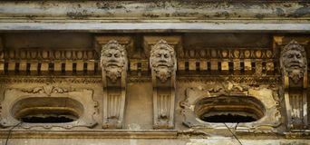 The old sculpture of the 18th century in the form of human heads, which adorns the facade of high-rise buildings in Lviv, Ukraine.  stock photo