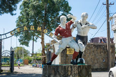 Old sculpture of two football players at the city stadium in Gag. Gagra, Abkhazia – April 15, 2016: Old sculpture of two football players at the city stadium Stock Photos