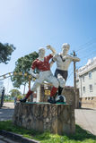 Old sculpture of two football players at the city stadium in Gag Royalty Free Stock Photography