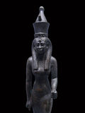 Old Egyptian sculpture of woman Stock Images
