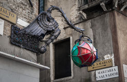 Dragon lamp post and Per S.Marco sign, Venice Italy Stock Images