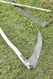 Old scythe in the field Royalty Free Stock Image