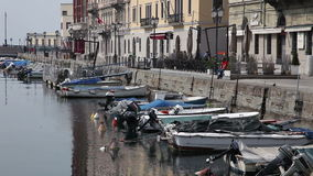 Old sea canal in Trieste full of boats stock footage