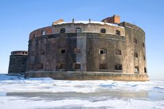 Old sea fort `Emperor Alexander the First` Plague close-up on a sunny March day. Kronstadt, Russia Stock Photos