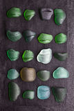Old sea glass bottlenecks Stock Photography