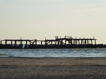 Old sea pier. And beach stock photography
