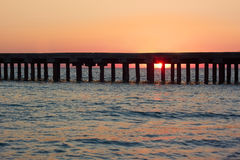 Old sea pier at sunset Stock Images