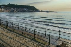 Old Seafront iron railings, View towards Scarborough. Weathered and Rusty railings and concrete steps stock image