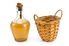 Old sealed bottle of white wine with basket Stock Photos