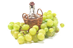 Old sealed bottle of wine and white grape Royalty Free Stock Photo