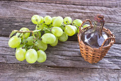 Old sealed bottle of wine and white grape Stock Images
