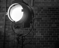Old searchlight against brick wall close-up. Black-white photo Royalty Free Stock Images