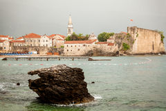 Old seaside city of Budva with high stone walls and towers Stock Photography