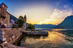 Old seaside town at sunset and mountains Royalty Free Stock Images