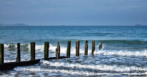 Old Seaside Wood Post Breaking Crashing Sea Waves Royalty Free Stock Image