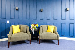 Old seat room with a blue wall royalty free stock images