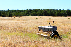 Old Seeder. Image of old seeder (seed planter) abandoned in a field Royalty Free Stock Photos