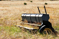 Old Seeder. Image of old seeder (seed planter) abandoned in a field Stock Photo