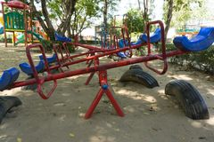 Old seesaw in outdoor playground for kids. Older playground equipment in Ecuador, teeter-totter, seesaw Stock Photography