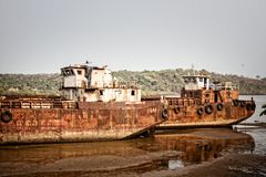 Old self-propelled barges. In the Indian port stock photos