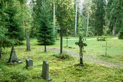 Old semetery in Finland with grave crosses and stones.  royalty free stock photos