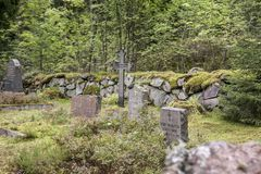 Old semetery in Finland with grave crosses and stones.  royalty free stock image