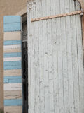Old semi-open wooden door. In blue, beige and white wood Royalty Free Stock Images