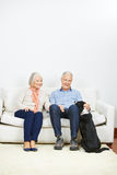 Old senior couple with dog at home Stock Image