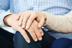 Old senior couple holding hands Royalty Free Stock Photography