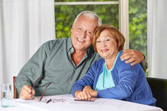 Old senior couple in retirement. Portrait of happy old senior couple in a retirement home royalty free stock photo