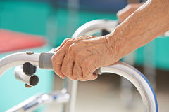 Old senior hands on a walker Stock Image