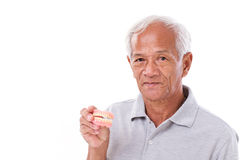 Old senior man with hand holding denture Stock Image