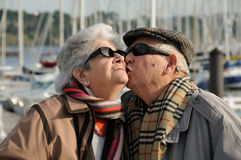Old senior man kissing his wife Royalty Free Stock Photo