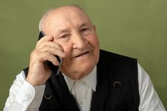 Old senior man portrait in grenn royalty free stock image