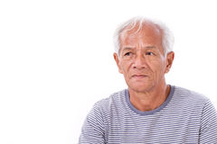 Old senior man suffering from eye disease, surfer's eye looking up Royalty Free Stock Photography