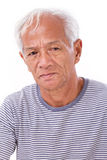 Old senior man suffering from eye disease, surfer's eye Stock Photos
