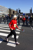 Old senior woman running with a rose Royalty Free Stock Photography