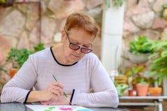 Old senior women having fun painting in art class outdoor. royalty free stock photos