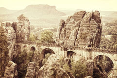 Old sepia postcard style Bastei bridge, Germany. Stock Photography