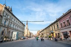 Old Serbian architecture and people walking down the city center in Novi Sad on the sunny autumn day. stock photo