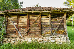 Old Serbian rural traditional wooden corn bar Stock Photo