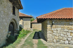 Old Serbian stone house. The old dilapidated country house by the roadside royalty free stock photography